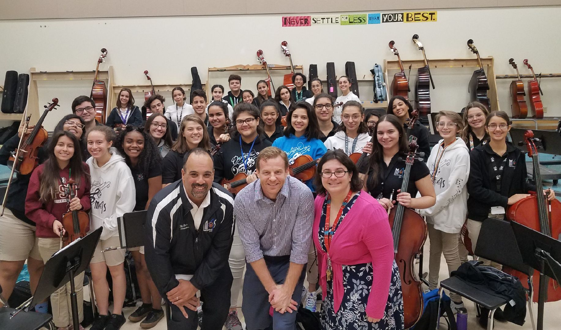 Winner Vivian Gonzalez and her Miami Arts School Orchestra with Principal Dr. Balsera and Give A Note Board Chair, Sean Smith.